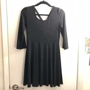 Black XXI dress with adorable cross in the back.